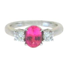 Three-Stone 18 Karat White Gold Oval Cut Natural Pink Sapphire and Diamond Ring