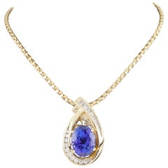 Tanzanite and Diamond 14 Karat Yellow Gold Pendant Necklace with Chain