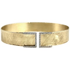 Yellow and White Gold Bangle with 0.32 Carat Diamond Accent