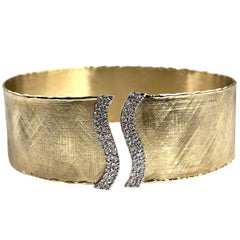 Yellow and White Gold Bangle with 0.65 Carat Diamond Accent