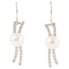 6.65 mm Cultured Pearl 0.25 Carat Diamond Earrings