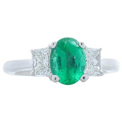1.10 Carat Oval Emerald and Trapezoid Diamond Cocktail Ring in 14 Karat Gold