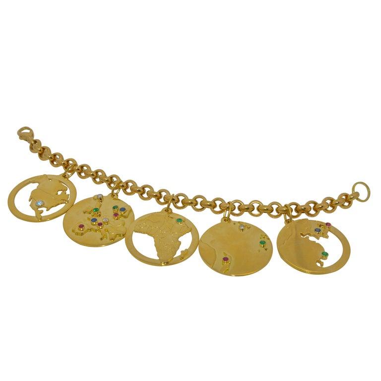 14 Karat Yellow Gold World Traveler Gemstone and Diamonds Charm Bracelet For Sale