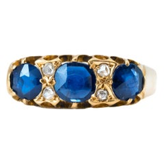 1920s Blue Sapphire and Diamond 18 Karat Yellow Gold Band Ring
