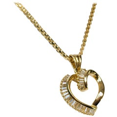 1 Carat Diamond Baguette Swirling Ribbon Heart Pendant 14 Karat Gold with Chain