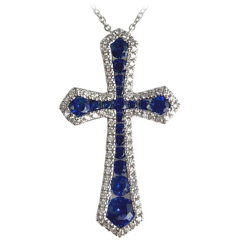 0.94 Carat Vivid Blue Sapphire and Diamond Cross Pendant in 18k White Gold For Sale