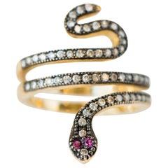 0.39 Carat Diamond and Ruby 14 Karat Gold Serpent Ring