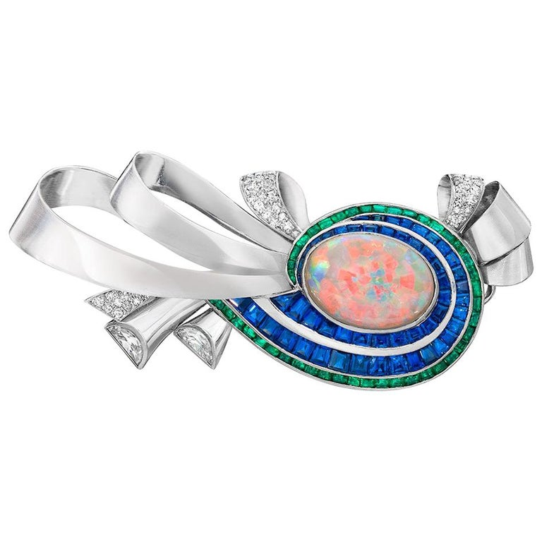 Midcentury Platinum Brooch with Opal, Diamonds, Emeralds, and Blue Sapphires For Sale