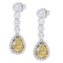 2.09 Carat Pear Shape Fancy Yellow Diamond Earrings in 18 Karat White Gold