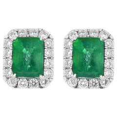 11.36 Carat Emerald Cut Emerald and Diamond Earrings in 18 Karat White Gold