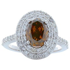 GIA Certified 2.08 Carat Oval Fancy Orangish Brown Diamond Cocktail Ring