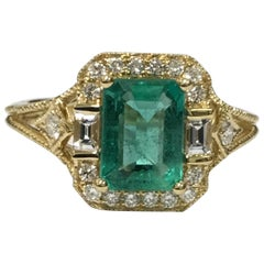 Emerald Diamond Ring Set in 18 Karat Yellow Gold