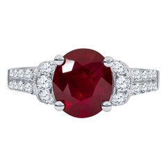 2.73 Carat Oval Cut Natural Ruby Ring with 0.58 Carat of Fine Round Diamonds