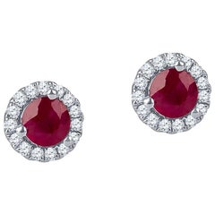 0.51 Carat Round Ruby Halo Stud Earrings with 0.13 Carat of Accent Diamonds