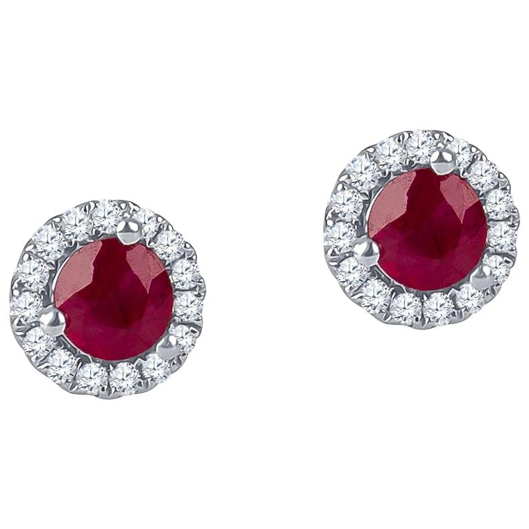 0.51 Carat Round Ruby Halo Stud Earrings with 0.13 Carat of Accent Diamonds For Sale