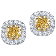 0.80 Carat Fancy Light Yellow Diamond Stud Earrings, 0.24ctw White Diamond Halo