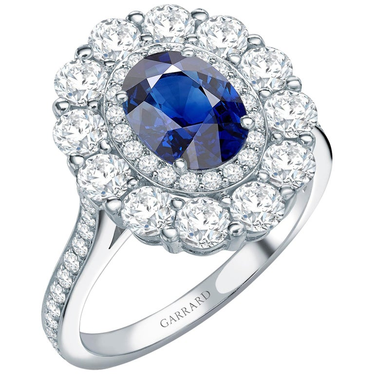 Garrard 1735 GIA Oval Blue Sapphire Diamond Platinum Cluster Engagement Ring For Sale