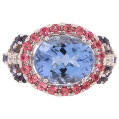 3.52 Carat Blue Beryl, Pink Tourmaline, and Iolite East West Ring