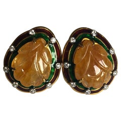 Set in 18 Karat Yellow Gold, Carved Sapphire and Enamel Studs with Diamonds