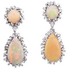 Set in 18K gold, Art Deco style Ethiopian Opal & baguette diamond drop earrings