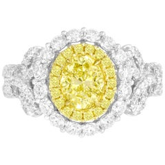 GIA Certified 0.98 Carat Oval Cut Natural Fancy Intense Yellow Diamond Halo Ring