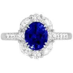 GAL Certified 1.83 Carat Oval Cut Ceylon Sapphire Halo Ring in 18 Karat Gold