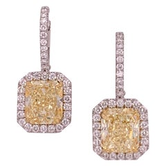 GIA 5.70 Carat Platinum and Gold Radiant Fancy Light Yellow Diamond Earrings VVS