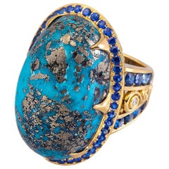 65.95 Carat Oval Turquoise and Sapphire 18 Karat Gold Ring