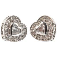 14 Karat White Gold and 0.50 Carat Diamond Heat Stud Earrings