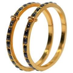22 Karat Yellow Gold Bangle Bracelets with Deep Blue Sapphires and Diamond, Pair