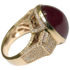 14 Karat Yellow Gold Ladies Oval Shaped Cabochon Ruby and Diamond Ring