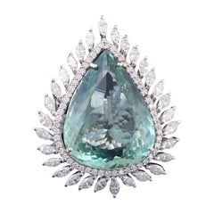 Set in 18K gold, pear shaped green aquamarine and marquise diamond cocktail ring