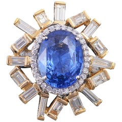 Set in 18K yellow gold, 5.64ct Blue Sapphire and baguette diamonds cocktail ring