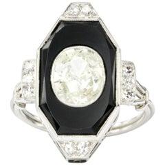 Art Deco Platinum Onyx and 1.3 Carat Oval Diamond Ring
