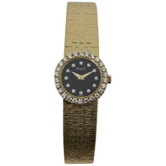Piaget Gold Watch with Diamond Bezel and Onyx and Diamond Dial