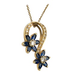 Playful Spinning Flowers Sapphire Diamond 18 Karat Yellow Gold Pendant on Chain