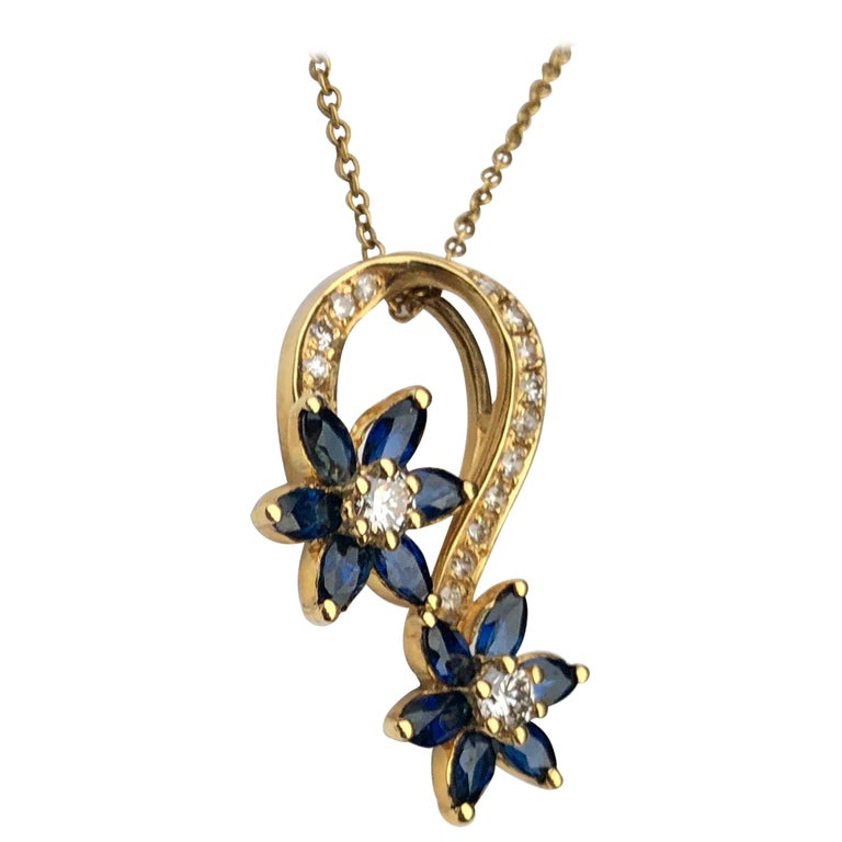 Playful Spinning Flowers Sapphire Diamond 18 Karat Yellow Gold Pendant on Chain For Sale