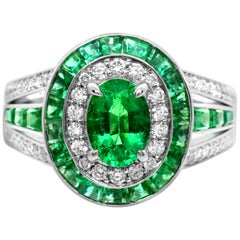 0.82 Carat Oval Emerald Baguette Ring with Diamonds 14 Karat Gold Cocktail Ring
