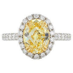 Fancy Yellow Oval Cut Halo Set Diamond Engagement Ring in Platinum 2.38 Carat