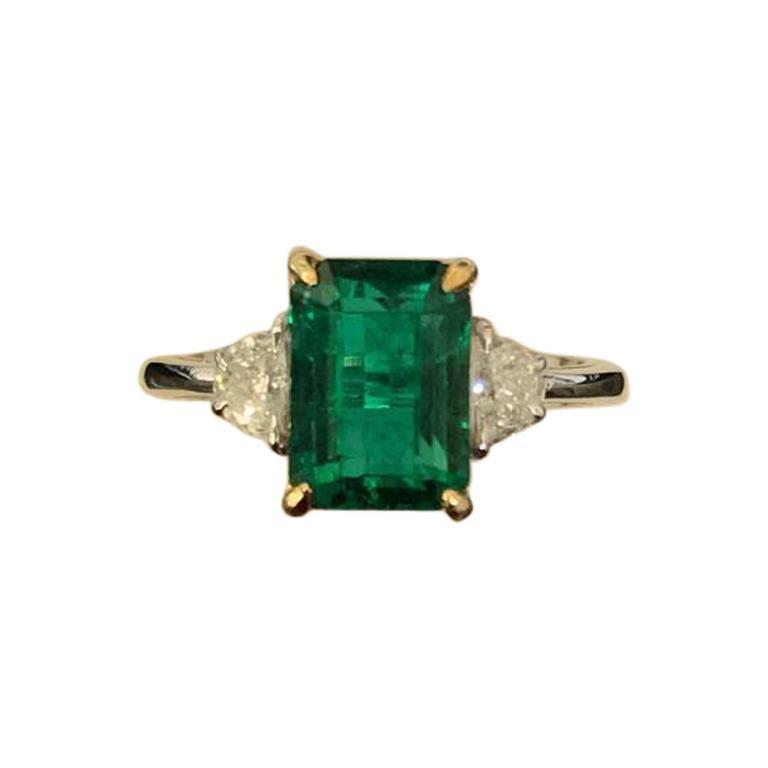 Certified 3.20 Carat Emerald and Diamond Three-Stone Engagement Ring