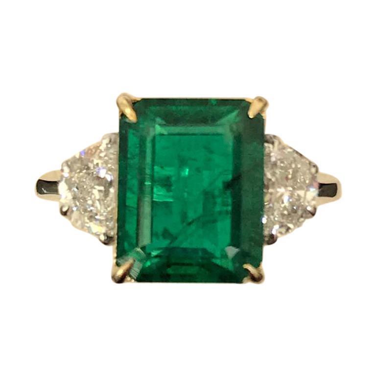 Certified 5.28 Carat Emerald and Diamond Three-Stone Engagement Ring