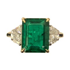 Certified 5.28 Carat Emerald and Diamond Three-Stone Engagement Ring