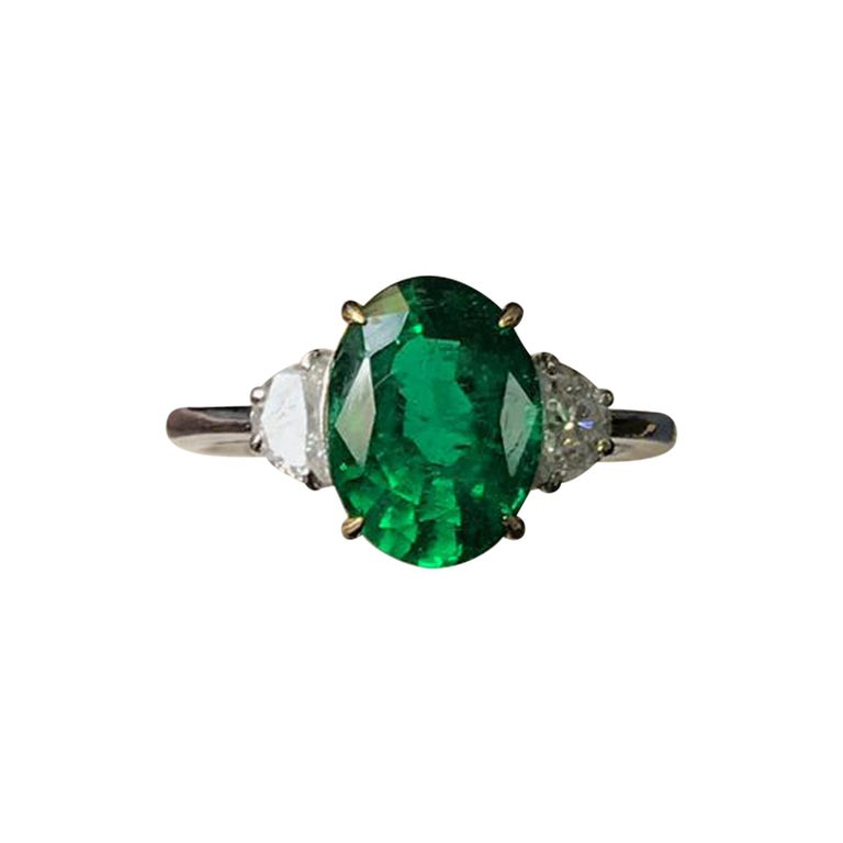 Certified 3 22 Carat Oval Emerald And Diamond Three Stone