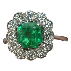Colombian Emerald and 1 Carat Diamond 18 Carat White Gold Cluster Ring