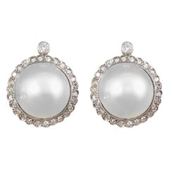 Vintage Cultured Pearl Diamond Halo Omega Clip Earrings in 18 Carat White Gold