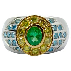 Blue and Yellow Diamonds Pairing with a Tsavorite in an 18 Karat White Gold Ring