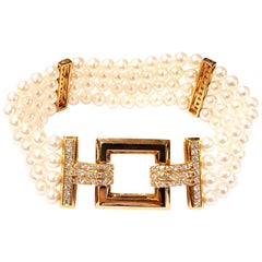 Four-Row Cultured Pearl Bracelet with 18 Karat Yellow Gold Diamonds