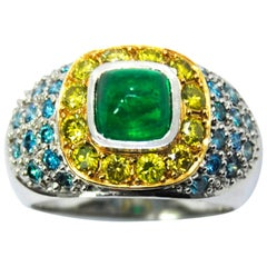 Cabouchon Emerald in a Tray of Blue and Yellow Diamonds in a 18 Karat White Ring