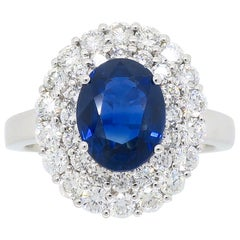 Diamond and Sapphire Princess Diana Style Ring in 18 Karat White Gold