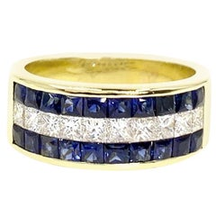 18 Karat Sapphire and Diamond Invisibly Set Ring